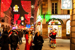 Christmas carols at the traditional Christmas market. STRASBOURG, FRANCE - DECEMBER 2014: Christmas carols at the traditional Christmas market in the historic royalty free stock photography