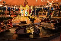 Christmas carousel is a favorite entertainment for children and adults on Christmas Day. Merry carousel for children and adults at the Christmas market in Stock Image