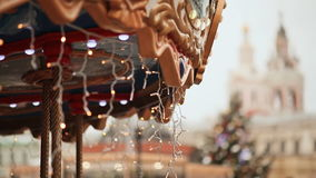 Christmas carousel rotating with children, decorated with illumination. Moscow. Area of the city. New Year theme. stock footage