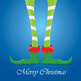 Christmas cartoon elfs legs on blue background Stock Images