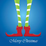 Christmas cartoon elfs legs on blue background Royalty Free Stock Images