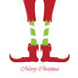 Christmas cartoon elfs legs on white background Stock Photography