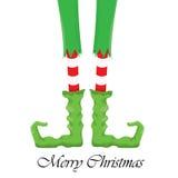 Christmas cartoon elfs legs on white background Stock Photo