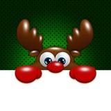 Christmas cartoon reindeer over green background holding blank Stock Image
