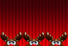 Christmas cartoon reindeers with holly looking up over red backg Stock Photography