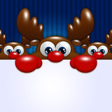 Christmas cartoon reindeers over blue background holding blank Royalty Free Stock Image