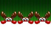 Christmas cartoon reindeers over green background holding blank Royalty Free Stock Photography