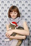 Christmas cat. The girl with a Christmas cat Royalty Free Stock Images