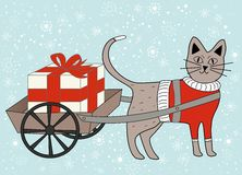 Christmas cat pulling gift/present in cart Stock Photography