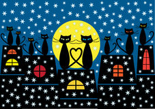 Christmas cats background. Color illustration of christmas cats and houses silhouettes by night Royalty Free Stock Image