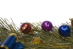Christmas cedar branch with ornaments. On a white background it is isolated Stock Photos