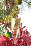 Christmas celebration. White champagne glass on Christmas background Royalty Free Stock Photo