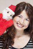 Christmas celebration by asian woman Stock Images