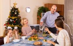 Christmas celebration in the bosom of family Stock Photos