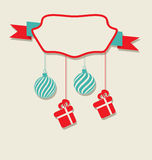 Christmas celebration card with hanging balls and gifts Stock Photos