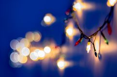 Christmas, celebration concept: blurred colorful lights on blue background Royalty Free Stock Photos