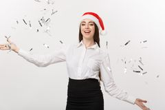 Christmas celebration concept - Young business woman throwing confetti for celebrating Christmas day  on white. Background Royalty Free Stock Images