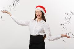 Christmas celebration concept - Young business woman throwing confetti for celebrating Christmas day isolated on white. Background Stock Photos