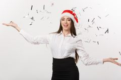 Christmas celebration concept - Young business woman throwing confetti for celebrating Christmas day isolated on white. Background Royalty Free Stock Photography