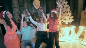 Christmas Celebration. Friends holding glasses of champagne making a toast. Cheers. HD stock video footage