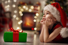 Christmas celebration. Funny smiling child in Santa red hat royalty free stock images