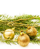 Christmas celebration with golden baubles. Christmas celebration with vintage golden baubles and pine branch. Room for your text. Isolated on white royalty free stock image