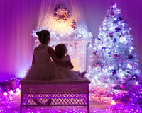 Christmas Celebration, Kids Back, Children Looking to Xmas Tree Royalty Free Stock Images
