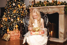 Christmas, celebration, people concept - happy child with gift Stock Photography