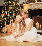 Christmas, celebration and people concept - happy family Stock Image