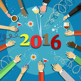 Christmas celebration 2016 with people hands and a glasses in their hands. Top view. People of different nationalities celebrate the New Year, holiday Royalty Free Stock Photo