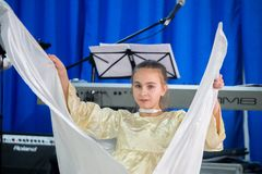 Christmas celebration in the Protestant Church `Renewal`. Girl play angel. royalty free stock photo
