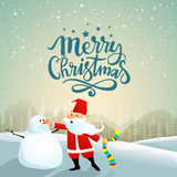 Christmas celebration with Santa Claus. Santa Claus making snowman on winter background for Merry Christmas celebration Stock Photos