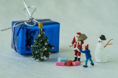 Christmas celebration story with miniature figure Santa claus gi Royalty Free Stock Images
