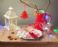 Christmas celebration table with plate and Christmas decorations Stock Photography