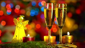 Christmas celebration with two champagne glasses. With bokeh background stock video