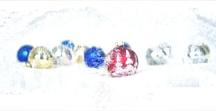 Christmas balls are going to be covered in snow. The Christmas celebrations between gifts decorations and toast for the new year Royalty Free Stock Photography