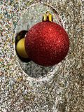 Xmas decorations red bauble and glitter royalty free stock photo