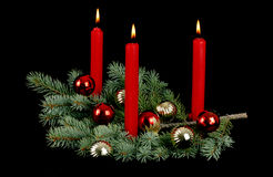 Christmas Centerpiece. With three lit candles Royalty Free Stock Image