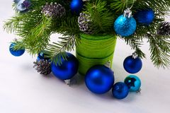 Christmas centerpiece with blue ornaments and fir branches in gr royalty free stock images