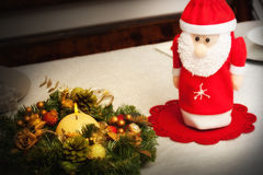 Christmas centerpiece with candle and bottle Royalty Free Stock Photo