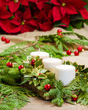 Christmas centerpiece with candles Stock Images