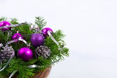 Christmas centerpiece with glitter cones and purple ornaments, c royalty free stock photography