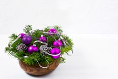 Christmas centerpiece with glitter and purple baubles, copy space. royalty free stock photos