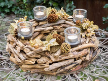 Christmas centerpiece on outdoor irony table Royalty Free Stock Images