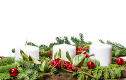 Christmas centerpiece with white candles Royalty Free Stock Image