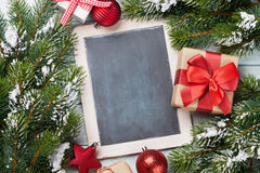 Christmas chalkboard, decor and fir tree Stock Images