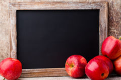 Christmas chalkboard and decoration over wooden background. Stock Image