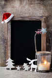 Christmas chalkboard with decoration. Santa hat, stars,  Wooden Stock Images