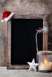 Christmas chalkboard with decoration. Santa hat, stars,  Wooden Stock Photos