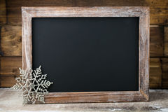 Christmas chalkboard with decoration. Santa hat, stars,  Wooden Royalty Free Stock Photos
